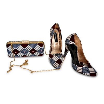 woman latest clutches bag with high heals.